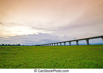 Bridge of railway cross grass field meadow at Pasuk River...
