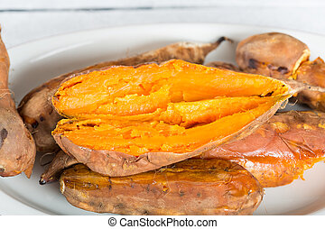 Sweet potatoes season - Juicy and delicious freshly cooked...