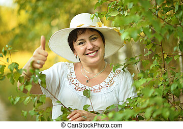 Lady with thumb up outdoors - Beautiful lady in hat enjoying...