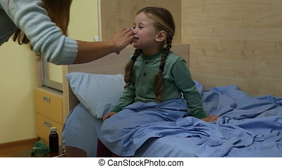 Mom treats her daughter - Mother sick child treated by...