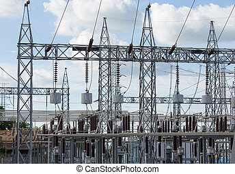 High voltage electric power substation with sky background