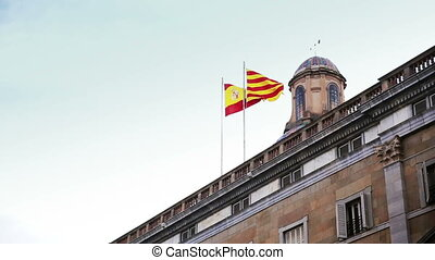 Waving flags of Spain and Catalonia - beautiful view of the...