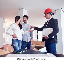 couple buying new home with real estate agent