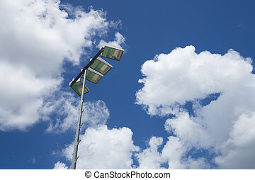 Light stadium or Sports lighting on cloudy sky background