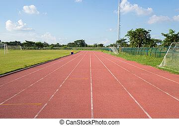 outdoor racetrack  - empty outdoor racetrack with blue sky