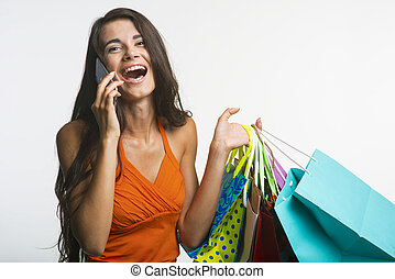 Surprised woman on shopping seasonal discounts - Seasonal...