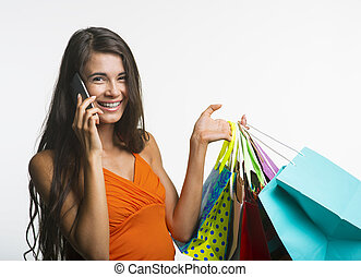 Merry woman on shopping during seasonal discounts - Seasonal...