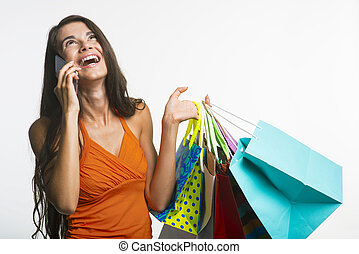 Merry lady on shopping during seasonal discounts - Seasonal...