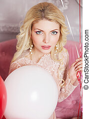 Romantic portrait of a beautiful girl with balloons