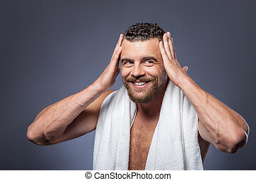 Attractive young guy is preparing for date