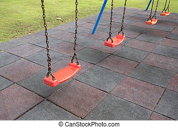 Empty swings on playground - Empty chain swings on...