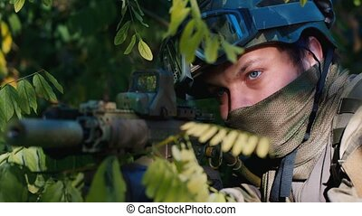 Portrait of the military. Playing airsoft