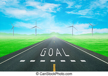 road through the green field with sign goal on asphalt -...