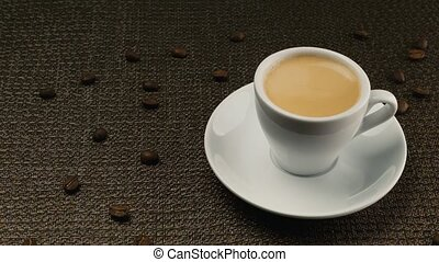 A cup of espresso on a dark napkin