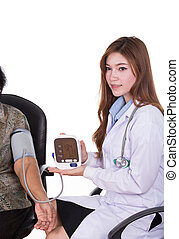 Female doctor measuring blood pressure of senior woman