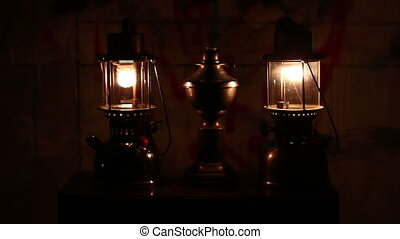 Oil lamp in dark night at home no electricity