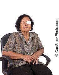 Medicine plaster patch on old woman injury wound eye on...