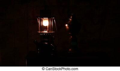Oil lamp in dark night