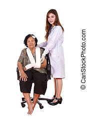 female doctor with senior woman injured on white background