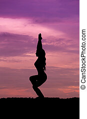 Silhouette of a beautiful Yoga woman