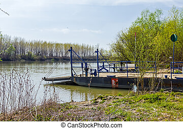 Empty ferry boat. - People are using manual ferry boat to...