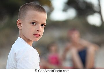 Young boy looking serious portrait