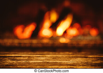Warm cozy fireplace with real wood burning in it. Cozy...