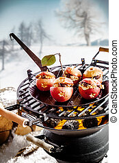 Tasty stuffed apples roasting on a grill - Tasty stuffed...