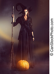 sorcery with broom - Gorgeous brunette witch with her broom...