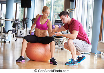 young sporty woman with trainer exercise weights lifting
