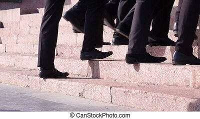 People Walking on Stairs. Legs.