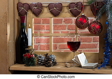 glass of wine at the window, with a christmas decoration - a...