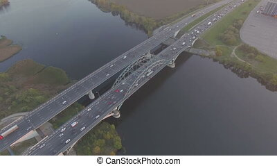 Cars on the bridge - Aerial sunset view of car traffic on...