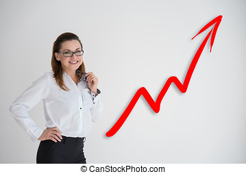 Pretty business woman drawing a graph