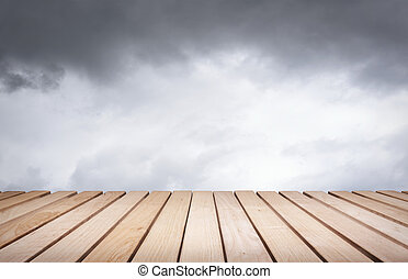 Wood platform and sky. - Wood platform and cloudy dark...
