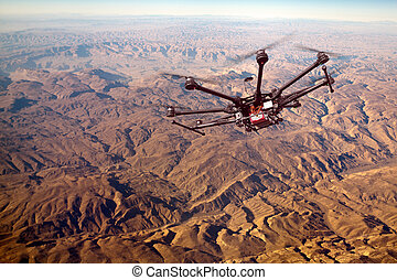Octocopter, copter, drone - RC copter flying over mountains...