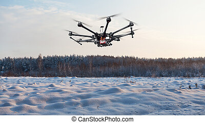 Octocopter, copter, drone - Flying copter with their gear on...