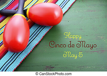 Happy Cinco de Mayo background with colorful maracas on...