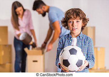 Family moving home - Young happy family moving to a new...