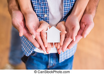 Family moving home - Hands of a happy young family holding...