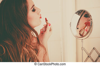 Young girl making makeup - Pretty girl making makeup in...