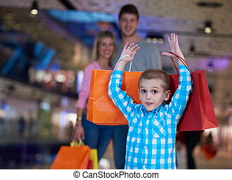 young family with shopping bags