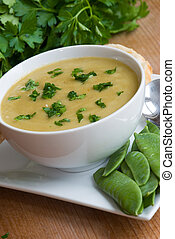 Ham and pea soup in a bowl
