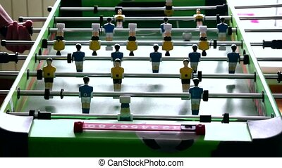 Table football game with yellow and blue players 4k