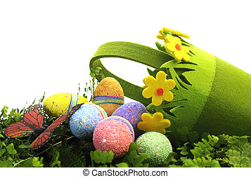 Happy Easter Egg Hunt Spring scene with pretty green and yellow daisy basket with eggs and butterfly with copy space for your text here.