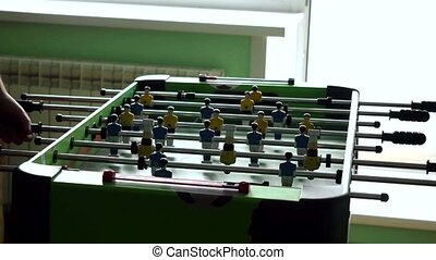 Table football game with yellow and blue players. 4k