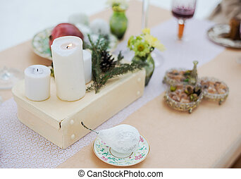 Winter evening outdoor candlelit dinner. Event decoration. -...