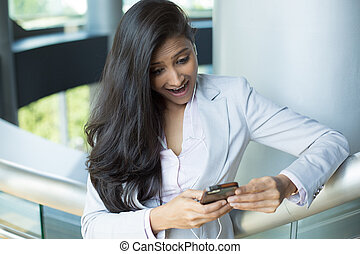 Surprised woman on cellphone - Closeup portrait of pretty...