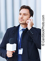 Smart-looking man is talking over the phone. - Listening...