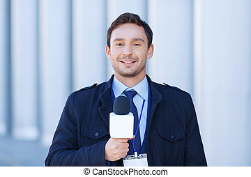Smiling journalist is ready to record reportings. - Ready to...
